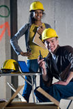 Construction workers. Multi-ethnic male and female construction workers on job site Royalty Free Stock Photo