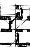 Construction Workers. Silhouettes building staples Royalty Free Stock Photos