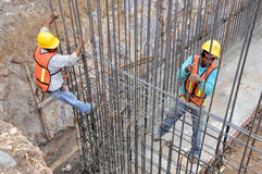Construction workers. Pic of a construction site, workers making a a wall Stock Photo
