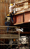 Construction workers. At work in the site Royalty Free Stock Photography