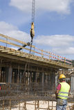 Construction workers. Pic of a construction site, workers making a a wall Royalty Free Stock Image