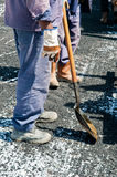 The Construction Workers. Construction workers working with asphalt pavement Royalty Free Stock Image