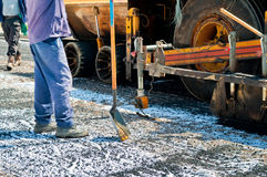 The Construction Workers. Construction workers working with asphalt pavement Stock Photography