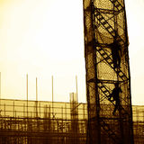 Construction workers. Working on scaffolding Stock Images