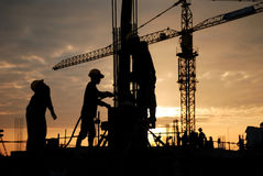 Construction workers. Silhouette of constructionworker on constructionsite Royalty Free Stock Photos