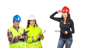 Construction workers. Three construction workers over a white background. Focus at front Stock Photography