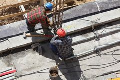 Construction workers. A view of two construction workers on a building project stock photos