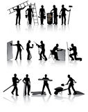 Construction workers. Isolated construction workers silhouettes with different tools Royalty Free Stock Photo