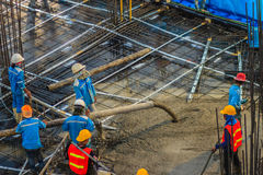 Free Construction Workers Are Pouring Concrete In Post-tension Flooring Work. Mason Workers Carrying Hose From Concrete Pump Or Also K Stock Image - 97463371
