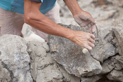 Construction workers build a stone wall Stock Images