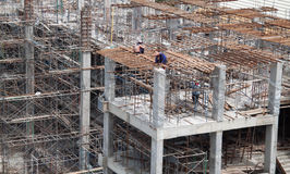 Construction workers are building. Construction workers are helping each other Stock Photo