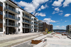 Construction workers building apartments - wide angle Royalty Free Stock Photo
