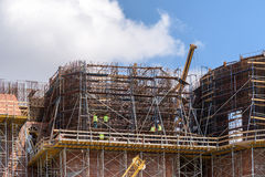 Construction Workers On Building Construction Site. Scaffold Royalty Free Stock Photography