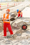 Construction workers building new road Stock Photo