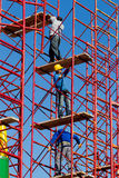 Construction workers building a new structure in city Stock Image