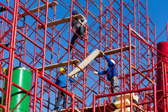 Construction workers building a new structure in city Stock Photography