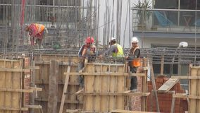 Construction Workers on Building Site stock video footage