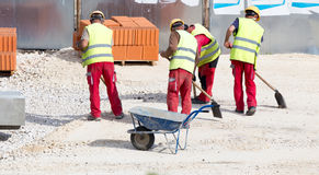 Construction workers at building site Royalty Free Stock Images
