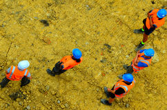 Construction workers or building site workers in a construction. Aerial view of an unrecognisable construction workers or building site workers in a construction Royalty Free Stock Photo