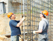 Construction workers checking Royalty Free Stock Photos