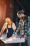 Construction workers checking checking blue print Royalty Free Stock Images