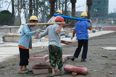Construction workers in Chengdu. Construction workers are carring bricks , in Chengud,China Stock Photo