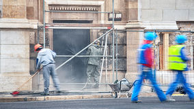 Construction workers cleaning a building Stock Photography