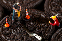Construction Workers in Conceptual Imagery With Cookies Stock Photo