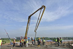 Construction workers with concrete pump crane Stock Photos