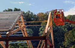 Construction Workers On A Crane Lift. Two construction workers on a crane lift working on a new building in the Smithsonian National Zoo in Washington DC Royalty Free Stock Images