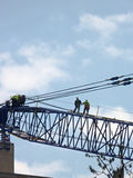 Construction workers on crane Stock Image
