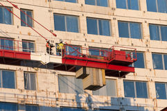 Construction workers on crane. At construction site. Arlanda, Sweden Stock Image