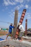 Construction workers are creating the pillar blocks Royalty Free Stock Photo