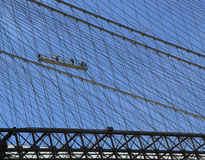 Construction workers crew repair cables on the  Brooklyn Bridge Stock Images