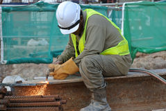 Construction workers cutting metal using blowtorch at the construction site Royalty Free Stock Photography
