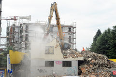 Construction workers during demolition of a house with a crane Royalty Free Stock Images