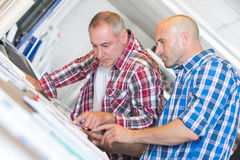 Construction workers discussing plan building in office Royalty Free Stock Images