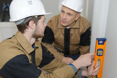 Construction workers discussing plan building in office Royalty Free Stock Photo