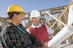 Construction Workers Discussing At Site Royalty Free Stock Images