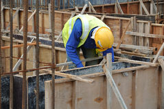 Construction workers fabricate ground beam formwork Royalty Free Stock Photos