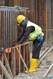Construction workers fabricate ground beam formwork Royalty Free Stock Images