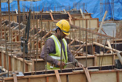 Construction workers fabricate ground beam formwork Stock Images