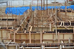 Construction workers fabricate ground beam formwork Royalty Free Stock Photo