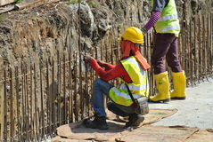 Construction workers fabricate retaining wall reinforcement bar at the construction site. Royalty Free Stock Photo