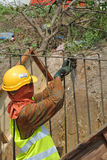 Construction workers fabricate retaining wall reinforcement bar at the construction site. Stock Photography