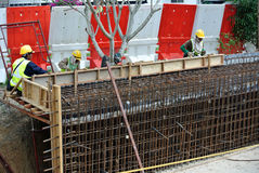 Construction workers fabricate retaining wall reinforcement bar at the construction site. Royalty Free Stock Photography