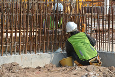 Construction workers fabricate steel reinforcement concrete wall at the construction site. Royalty Free Stock Photo