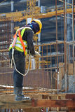 Construction workers fabricating beam steel reinforcement bar Royalty Free Stock Images