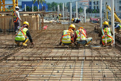Construction workers fabricating floor slab reinforcement bar Royalty Free Stock Image
