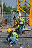 Construction workers fabricating floor slab reinforcement bar Royalty Free Stock Photo